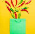 Above view at Chili pepper and shopping bag Royalty Free Stock Photo