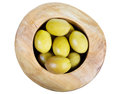 Above view of green olives in wooden bowl isolated Royalty Free Stock Photo