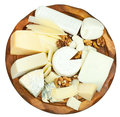 Above view of wooden plate with various cheeses Royalty Free Stock Photo