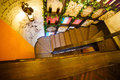 The above view of the wooden staircases in the cafe decorated with wooden shelves full of barrels, plants and bottles Royalty Free Stock Photo