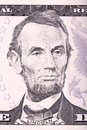 Abraham Lincoln portrait from five dollars bill.