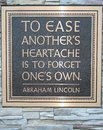 Abraham lincoln quote beautiful plaque written by to remind us that heartache is best forgotten if give of ourselves Stock Photos