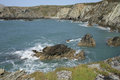 Abraham s bosom bay a view from a cliff top across the sea with rocks to cliffs enclosing wales coast path anglesey wales uk Stock Images