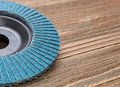 Abrasive wheel on wooden background Royalty Free Stock Photos
