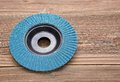 Abrasive wheel on wooden background Stock Photography