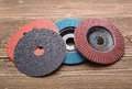 Abrasive wheels on wooden background Stock Images