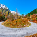 Abrupt bend in the asphalt road in the italian alps Royalty Free Stock Images
