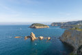 Abrupt javea coastline at portichol bay with its landmark island in the background Stock Photo