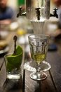 Absinth glass and fountain Royalty Free Stock Photo