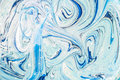 Abstract acrylic paint mix mixing blue color scheme with a bright white interior with liquid texture Stock Images