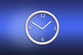 Abstract analog wall clock on blue background Stock Images