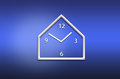 Abstract analog wall clock on blue background Royalty Free Stock Photography
