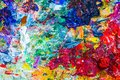 Abstract artistic palette closeup view of the with mix of oil paint free combination of colors working tool of an Stock Photo