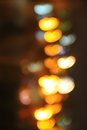 Abstract background of blurred city lights with hearts shape bokeh effect Royalty Free Stock Photo