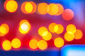 Abstract background of blurred lights with bokeh effect warm cool blue and purple Royalty Free Stock Photos
