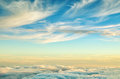 Abstract background with gold and blue colors clouds. Sunset sky above the clouds.