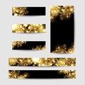 Abstract background with gold sparkles. Shiny defocused gold bokeh lights on black background.