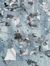 Abstract background of  grunge dirty wall. Traces of papers were torn from a rusty light blue metal wall Royalty Free Stock Photo