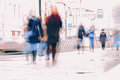 Abstract background. Intentional motion blur. City in the early spring. Street, people walking along the sidewalk Royalty Free Stock Photo