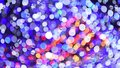Abstract background moving blurred colored lights garland