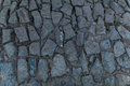 Abstract background of old cobblestone pavement close-up. Royalty Free Stock Photo