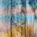 Abstract background old wooden fence painted in different bright colors Stock Photography
