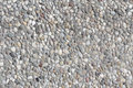Abstract background paving consisting of small pebbles embedded in cement Stock Photography