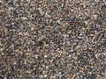 Abstract background with pebbles small round sea stones Beach rocks Texture material nature Royalty Free Stock Photo