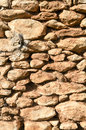 Abstract background of a stone wall of an old farmhouse in Andalusia Royalty Free Stock Photography