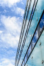 Abstract background texture with bright clouds reflected in wind windows of modern office building Royalty Free Stock Photo