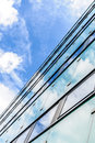Abstract background texture with bright clouds reflected in wind windows of modern office building Stock Images