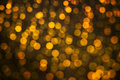 Abstract backgroung of golden glitter and glow soft bokeh shining light. Dreamy sparkle background Royalty Free Stock Photo