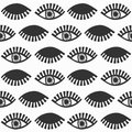 Abstract black blinking feminine eyes with lashes pattern on white