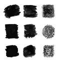 Abstract black marks a set of on white markings resembling charcoal scratchings or paint brush strokes Royalty Free Stock Image