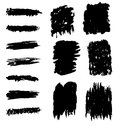 Abstract black marks a set of on white markings resembling charcoal scratchings or paint brush strokes Royalty Free Stock Photo