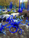 Abstract blue blown glass sculpture garden the varied shapes tall and long round and squat curly and wild of these chichuly Royalty Free Stock Photo