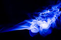 Abstract blue smoke swirls over black background Royalty Free Stock Photo