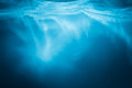 Abstract blue water background with sunbeams Royalty Free Stock Photo