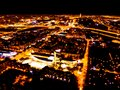 Abstract Blurred background Aerial night view of a big city. Cityscape panorama bokeh at night. Blurry Aerial view of skyscraper a Royalty Free Stock Photo