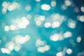 Abstract blurred image of sparkling blue water with bokeh background.
