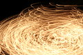 Abstract blurred swirl light lines on dark background