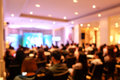 Abstract blurry a lot of people seminar