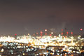 Abstract bokeh of petrochemical plant at industial estate night time Stock Image