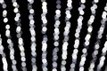 Abstract bokeh of white lights on black background. defocused and blurred many round light Royalty Free Stock Photo