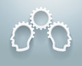 Abstract brainstorming workgroup representation of a two heads with gears on a blue background Stock Image