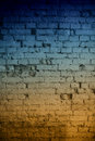 Abstract brick wall background close up of old in blue and light orange shades Royalty Free Stock Photos