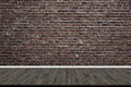 Abstract brick wall and wood floor in room for artwork Royalty Free Stock Photo
