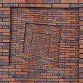 Abstract brown red spiral brick wall pattern background texture. Brown grunge brick wall spiral pattern fractal background brick w Royalty Free Stock Photo
