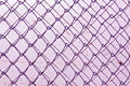 Abstract chain link fence texture against grungy color wall background and for design Stock Image