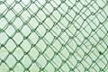 Abstract chain link fence texture against grungy color wall background and for design Stock Images